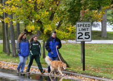 Naomi Shapiro, center, walks with her parents Debbie and Jerry Isaak-Shapiro, with family dog Nala, to the Northeast District cross country meet held at Lakeland Community College on Saturday, Oct. 18, 2014. Shapiro, who runs for Laurel School, and her family observe Jewish tradition of not using mechanical devices such as a car on the Sabbath, so they walk to her meets. (Thomas Ondrey/The Plain Dealer)