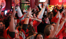 Fans celebrate Ohio State University's victory over the University of Oregon in the national championship game Monday, January 12, 2015 at the Dive Bar in Cleveland. (Joshua Gunter, Northeast Ohio Media Group)