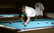 Cardale Jones playing a game of pool. (Courtesy of Karin McKenna)
