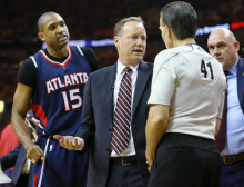Atlanta Hawks' Al Horford, left, and head coach Mike Budenholzer argue a foul call with an official before Horford was ejected from the game against the Cleveland Cavaliers during Game 3 of the Eastern Conference finals of the NBA basketball playoffs, Sunday, May 24, 2015, in Cleveland. The Cavaliers defeated the Hawks, 114-111. (Curtis Compton, Atlanta Journal-Constitution via AP)