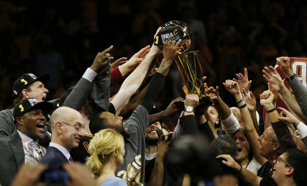 The Cleveland Cavaliers hoist the Larry O' Brien NBA Championship trophy are defeating the Golden State Warriors 93-89 to win the NBA Championship. (Gus Chan, The Plain Dealer)