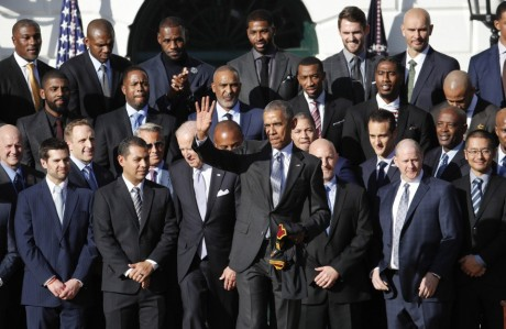 President Barack Obama waves to guests after posing for a group photograph with members of Cleveland Cavaliers basketball team on the South Lawn of the White House in Washington, on Thursday, following a ceremony where the president honored the 2016 NBA champion Cleveland Cavaliers basketball team. During the Cavs visit, the group met with the President's staff to discuss discuss steps in improving relationships with local law enforcement departments and Cleveland communities, and building stronger areas across the country. (Manuel Balce Ceneta, AP)